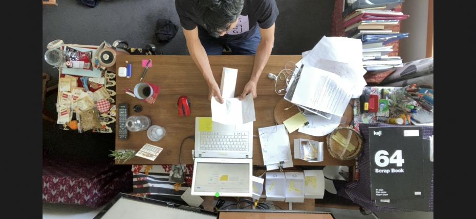 Artist Takashi Takiguchi at his desk